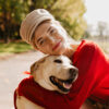 Dog Owner Considering The Cost of Knee Surgery